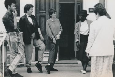 Six members/workers from the Greenwich Lesbian and Gay Centre talking outside West Greenwich House during the Grand Tea Dance/AGM of 1988