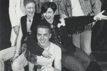 Group of six people smiling and posing in a photoshoot for volunteers at The Metro Centre, 1995