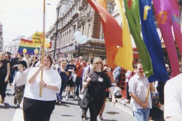 Marchers holding Metro rainbow banner at central London Pride, 1998