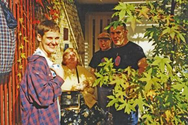 Group of four Metro Centre staff and service users at World Mental Health Day event, 1998