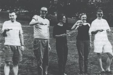 Five participants in an egg-and-spoon race in Greenwich Park at a Metro Centre event, 1998