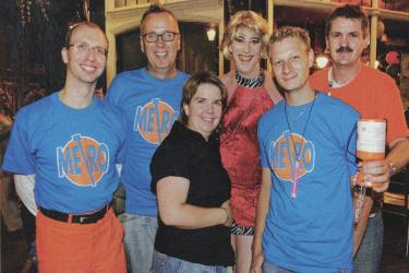 A group of six Metro staff at a fundraising event, some wearing branded t-shirts at the Rose and Crown pub, Greenwich, 2006