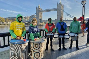 METRO with people from South London Samba drumming in front of London Bridge and the Thames