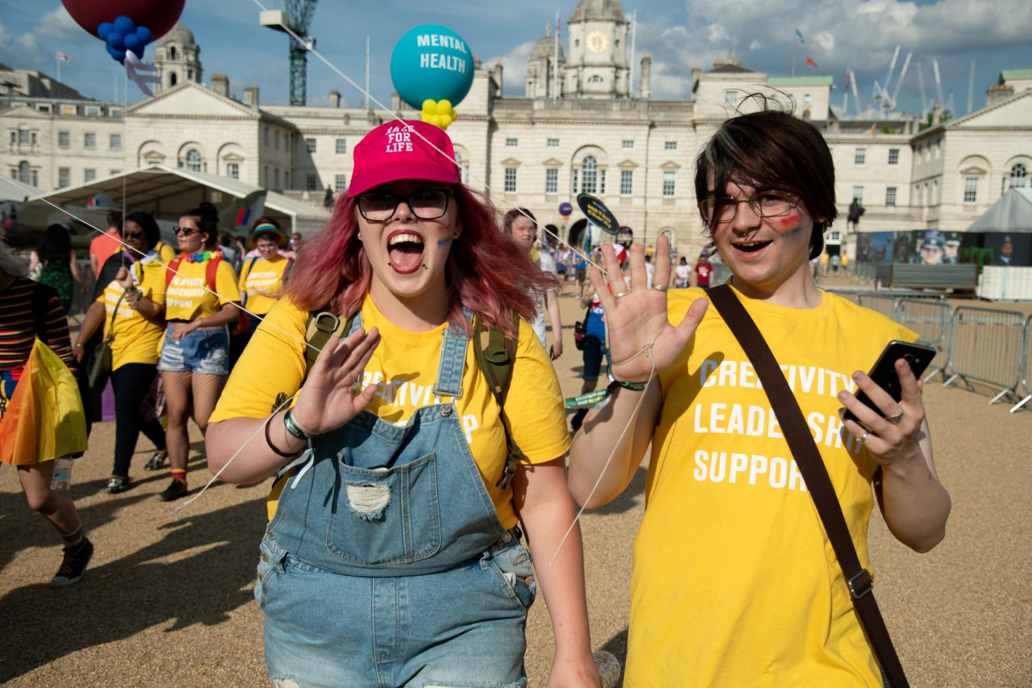 Two young people wearing METRO youth t-shirts after Pride in London