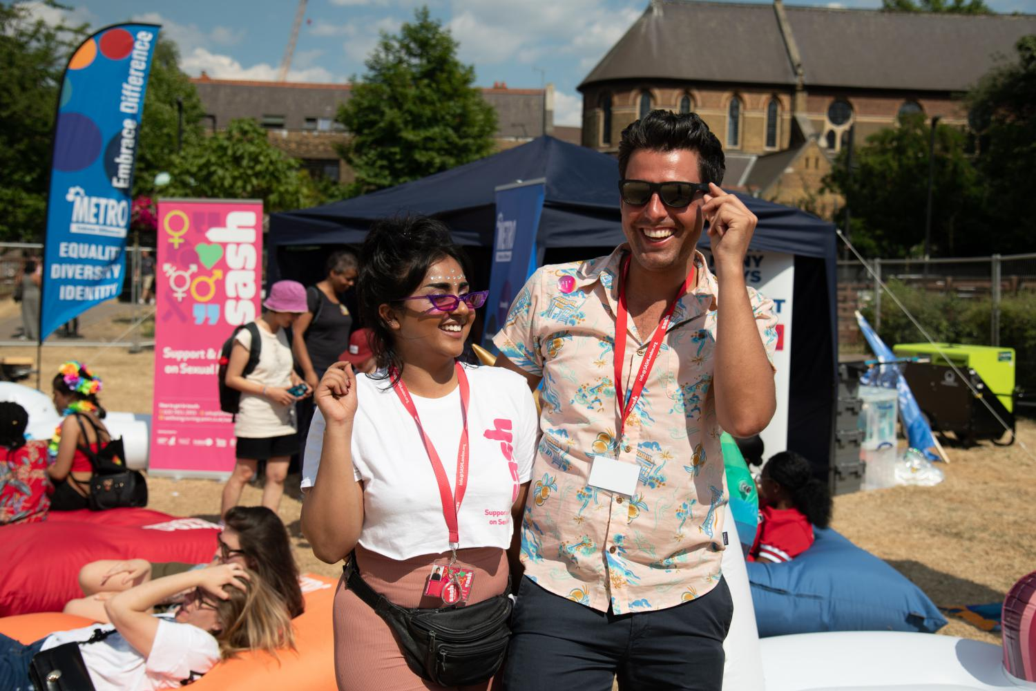 Staff from SASH in front of the METRO stall at Essex Pride