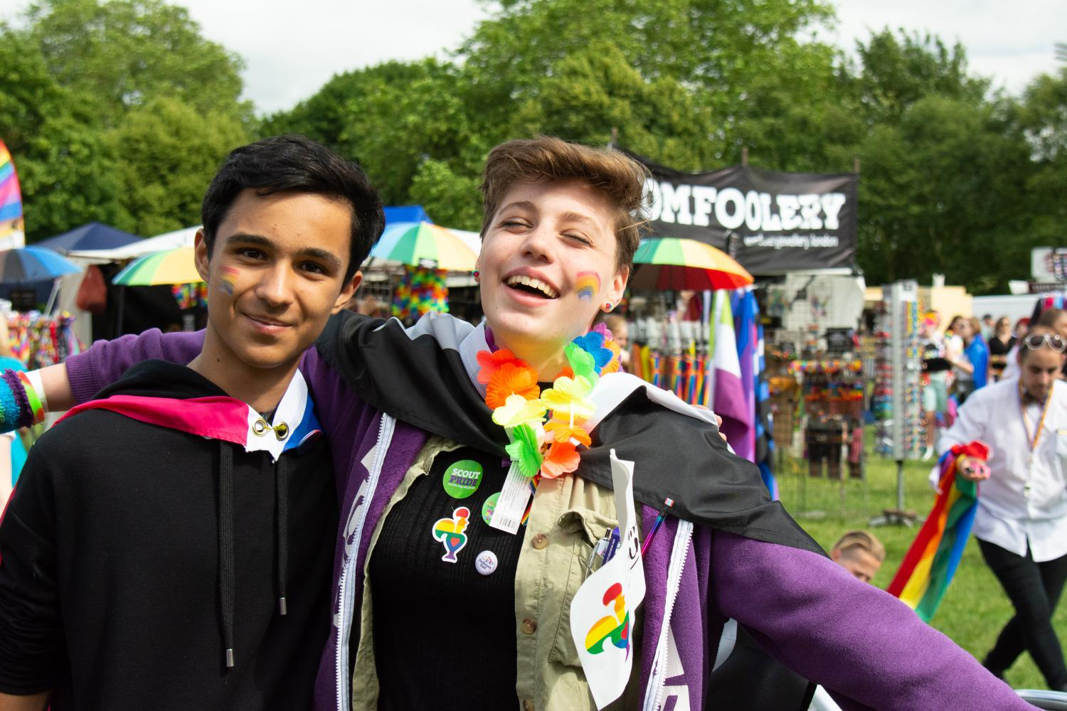 Young people wearing the bisexual and asexual flags at Essex Pride