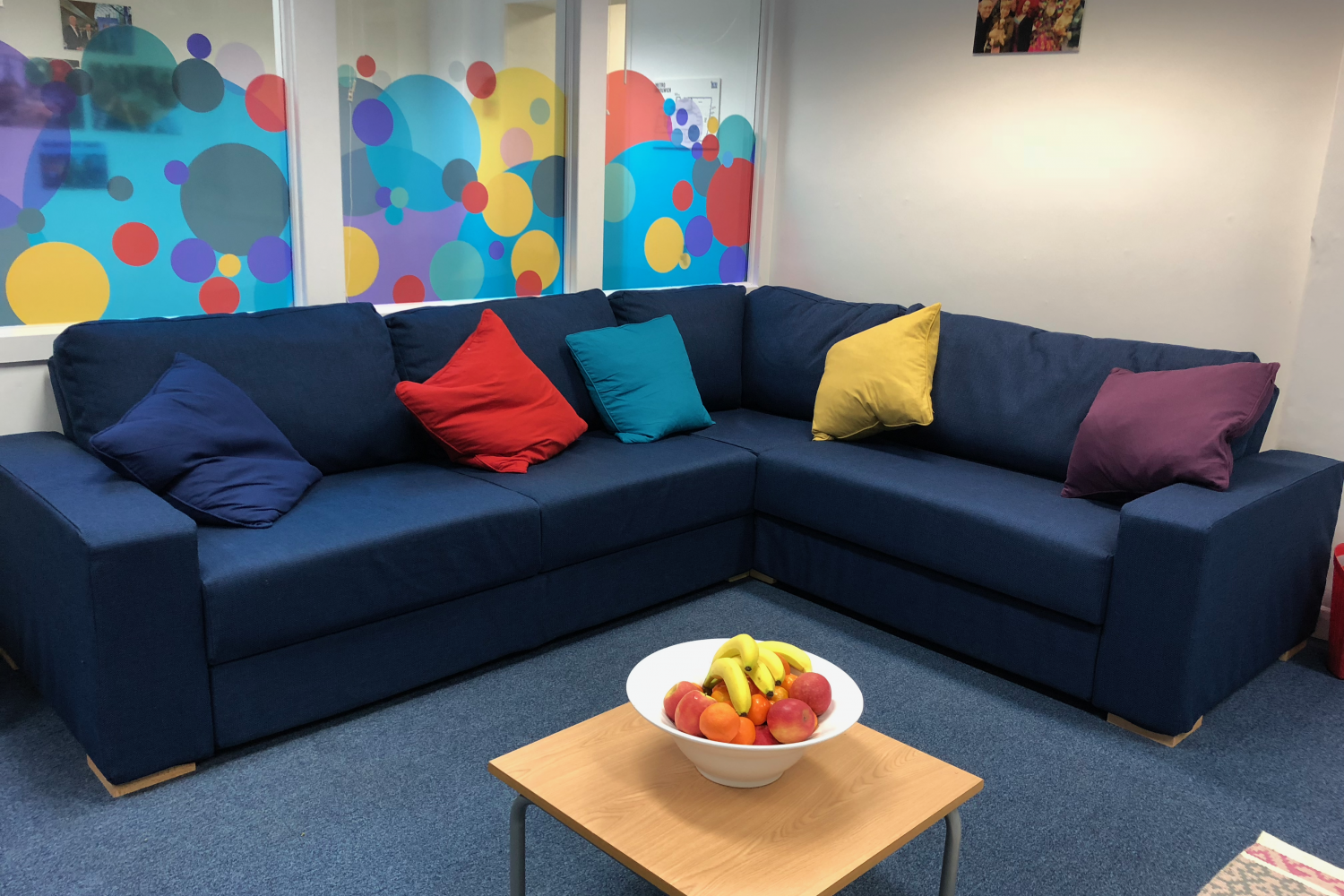 METRO Woolwich breakout room with a bowl of fruit in front of the sofa
