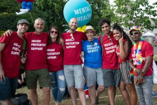 Some of our HIV team in St James' Park, wearing METRO t-shirts with the slogan Insight, Prevention, Support