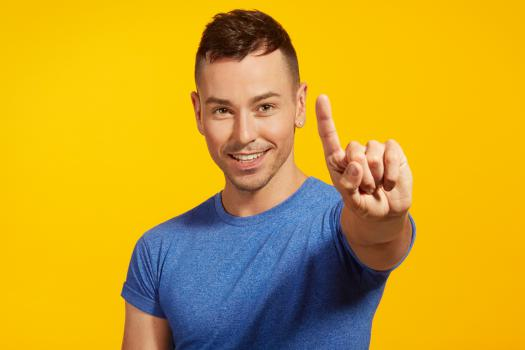 Man holding a finger up to Give HIV the Finger for National HIV Testing Week