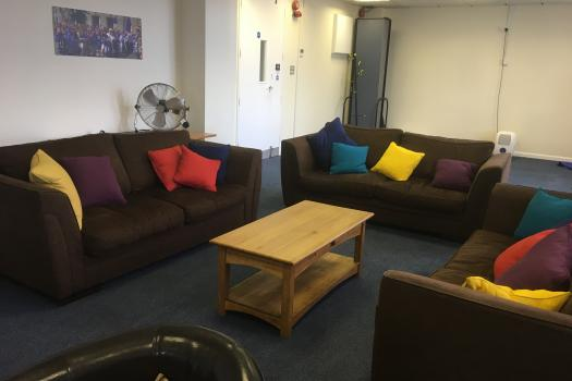 METRO Woolwich - Main Room - Three sofas with colourful cushions around a coffee table