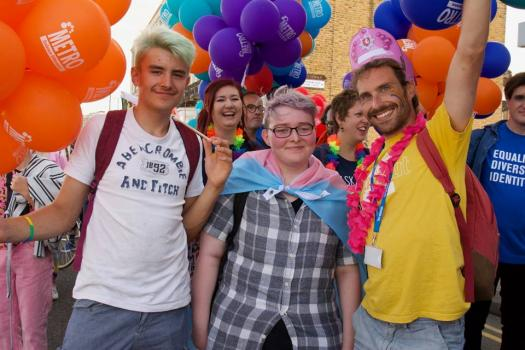 Young people at Margate pride wearing the trans flag