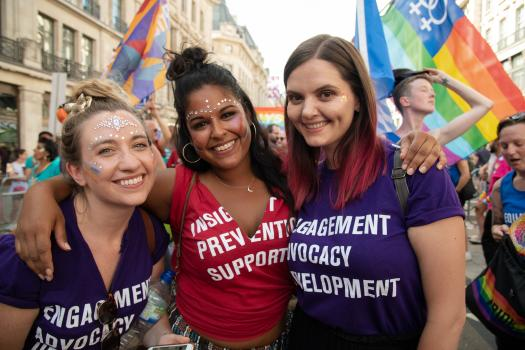 METRO staff wearing purple and red t-shirts at Pride in London