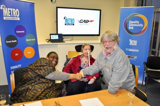 Gwen, Sue and John at our merger agreement signing