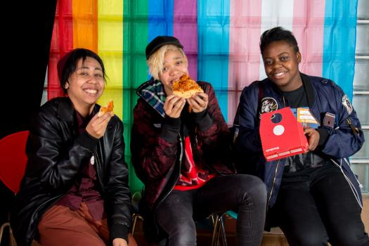 Young people eating pizza at the METRO Youth Summit in Southwark in 2018