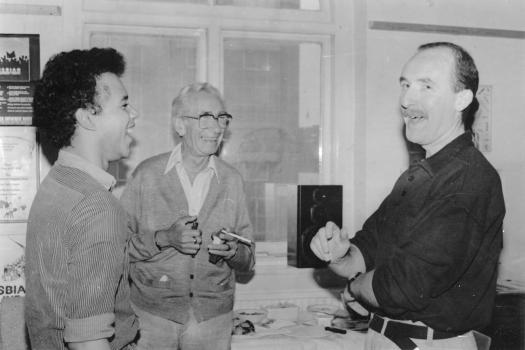 Three men laughing together at the Greenwich Lesbian and Gay Centre, 1989