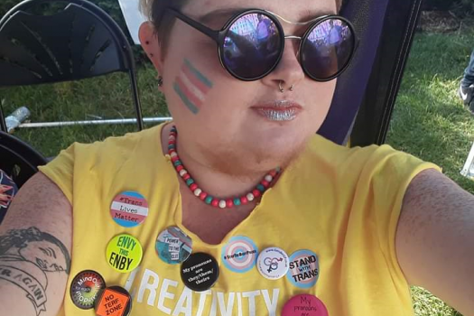 Our Alex wearing sunglasses at Pride