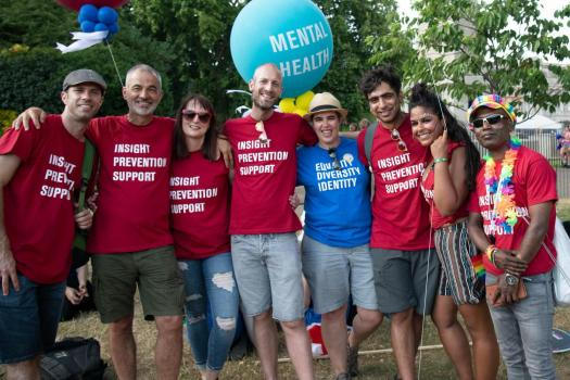 Group of METRO staff with Mental Health balloon