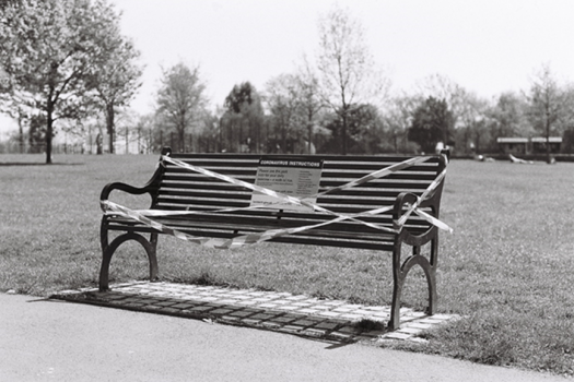Photo of a park bench tapes off