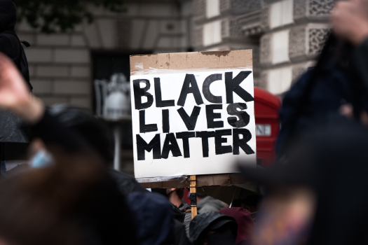 Photo to Black Lives Matter placard at protest in London